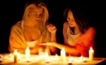 Two girls guessing in the darkness with candles - Вечер Елабуги